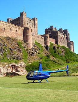 Charter flight to Bamburgh Castle in a Robinson R44
