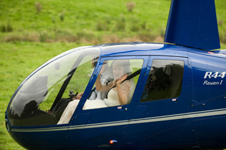 Weddings - Close up of bride in Robinson R44 helicopter