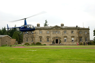 Weddings - Helicopter landing outside Manor House, where the wedding will occur
