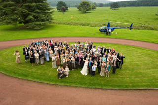 Weddings - The Wedding Party in front of the Robinson R44 Raven I